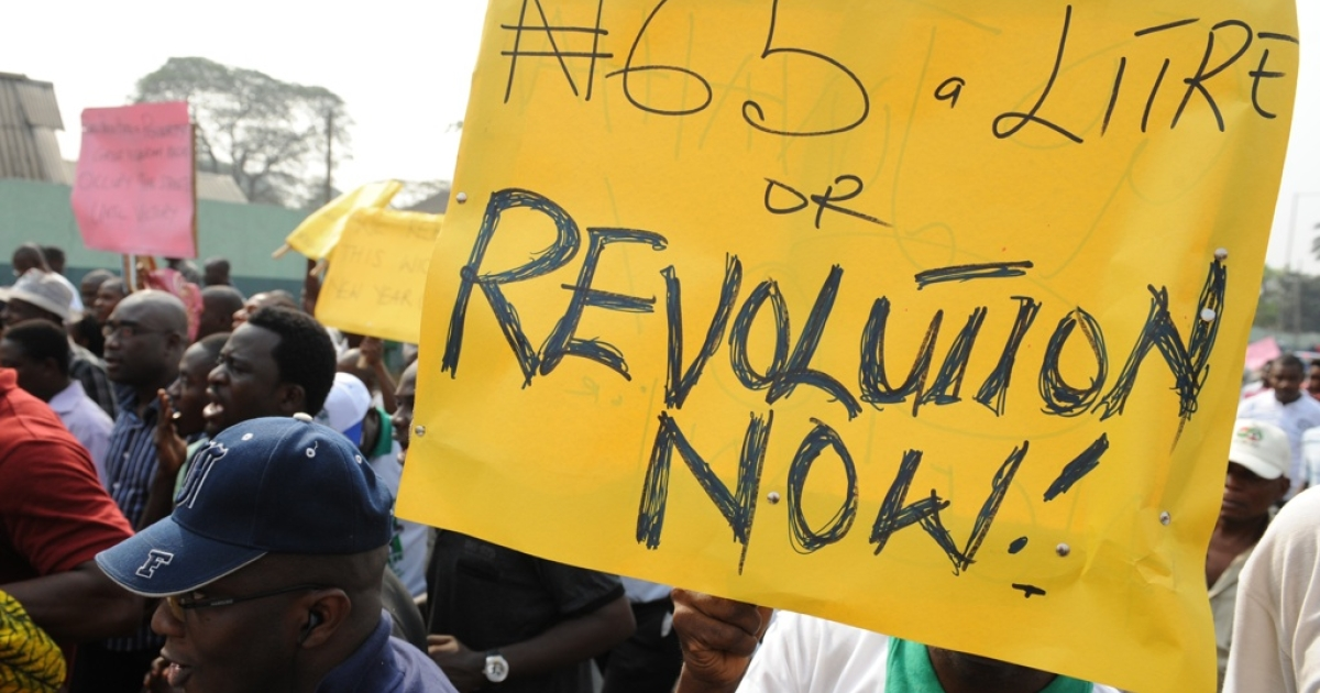 Nigerian union members and demonstrators march in Lagos to protest the removal of petroleum subsidies by the government on January 3, 2012. Nigerian police fired tear gas to disperse a small crowd burning tires in Lagos and arrested demonstrators in the northern city of Kano on Tuesday as protests continued over soaring fuel prices.</p>