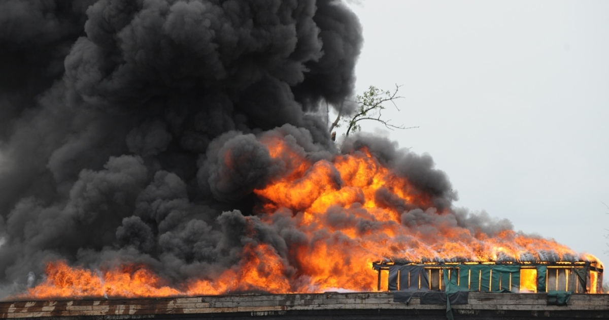 A Chevron oil rig off Nigeria is now a raging inferno. Here a fire burns with crude oil seized by the Nigerian military from oil thieves in the Andoni area of Rivers State on April 12, 2011.</p>