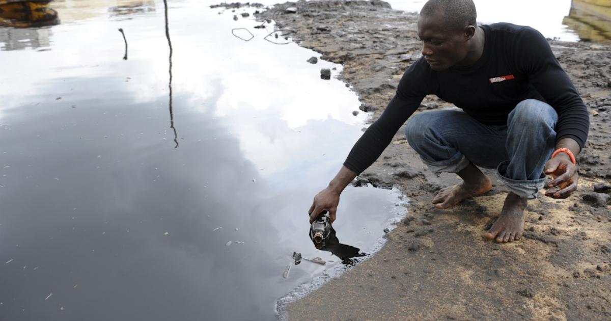 A man scoops spilled crude oil into a bottle from the waters of the Niger Delta swamps of Bodo, a village in the famous Nigerian oil-producing Ogoniland, which hosts the Shell Petroleum Development Company (SPDC) in Nigeria's Rivers State. The region has in recent years experienced an average of 300 spills a year, roughly one spill a day, from terminals, pipes and platforms, according to government officials and experts. Sabotage of oil facilities by armed rebels fighting for a fairer share of oil wealth for locals, and theft of crude, popularly known as oil bunkering, in recent years saw spills spiking to new levels.</p>