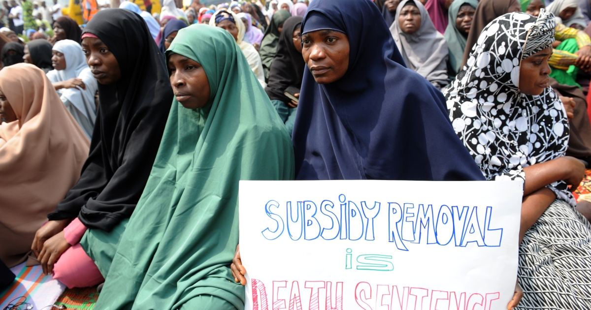 Muslim women hold placards during Friday prayers in Lagos, Nigeria. The protests against the cancellation of a fuel subsidy that sent prices soaring was suspended Monday, Jan. 16, after Nigerian President Goodluck Jonathan agreed to cut gas prices.</p>