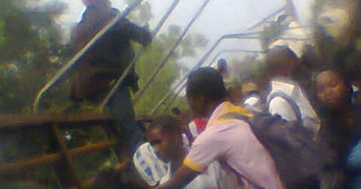 A picture taken October 2, 2012 at the Mubi morgue shows students gathering shortly after a massacre in a student housing area that left at least 40 dead. Nigerian police said on October 3, 2012 they had arrested many suspects following a massacre at a student housing area that left at least 40 people dead, with victims shot or their throats slit. The raid in the early hours of Tuesday near a polytechnic university shook the town of Mubi in Nigeria's volatile northeast, where Islamist extremist group Boko Haram has carried out scores of previous attacks.</p>