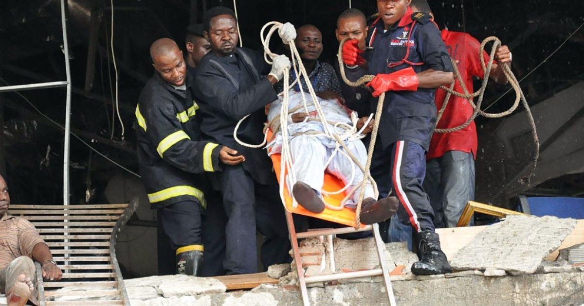 Rescue workers evacuate on August 26, 2011 a wounded man from the UN building of the Nigerian capital Abuja which was rocked by a bomb that killed at least 18 people, leaving others trapped and causing heavy damage. The attack by radical Islamist sect Boko Haram marked a significant escalation in the violence.</p>