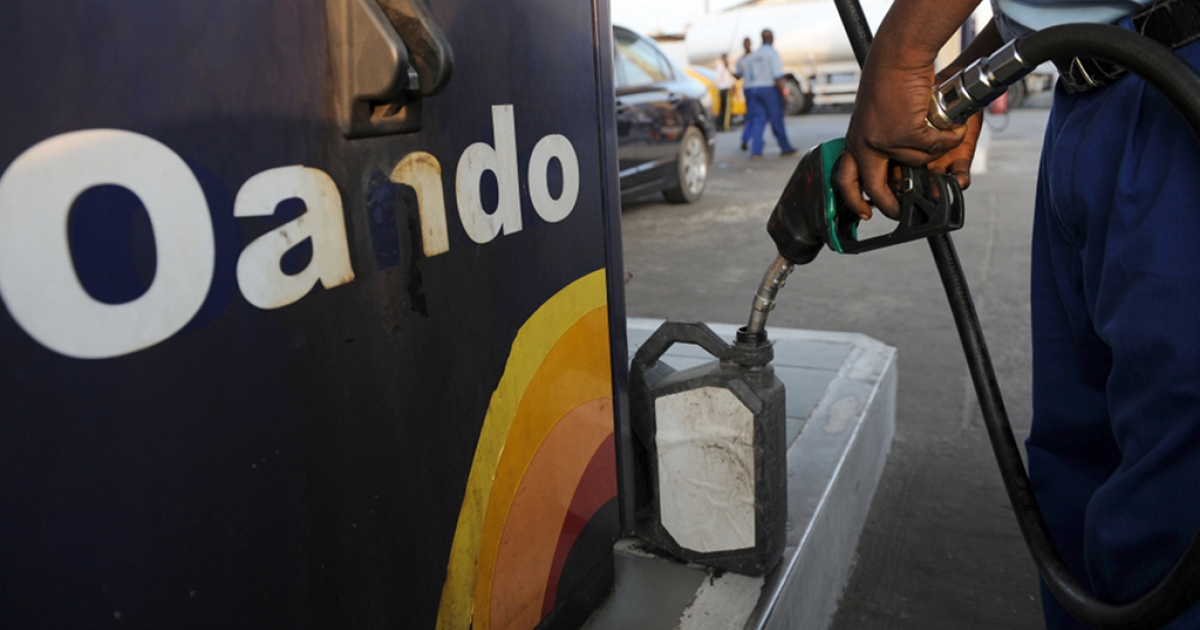 An attendant sells fuel in a jerry can at a filling station in Lagos on November 10, 2011.</p>
