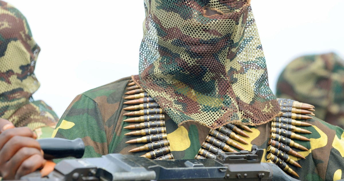 A fighter of the Movement for the Emancipation of the Niger Delta (MEND), holds his heavy machine-gun at the militia's creek camp in the Niger Delta in September 2008.</p>