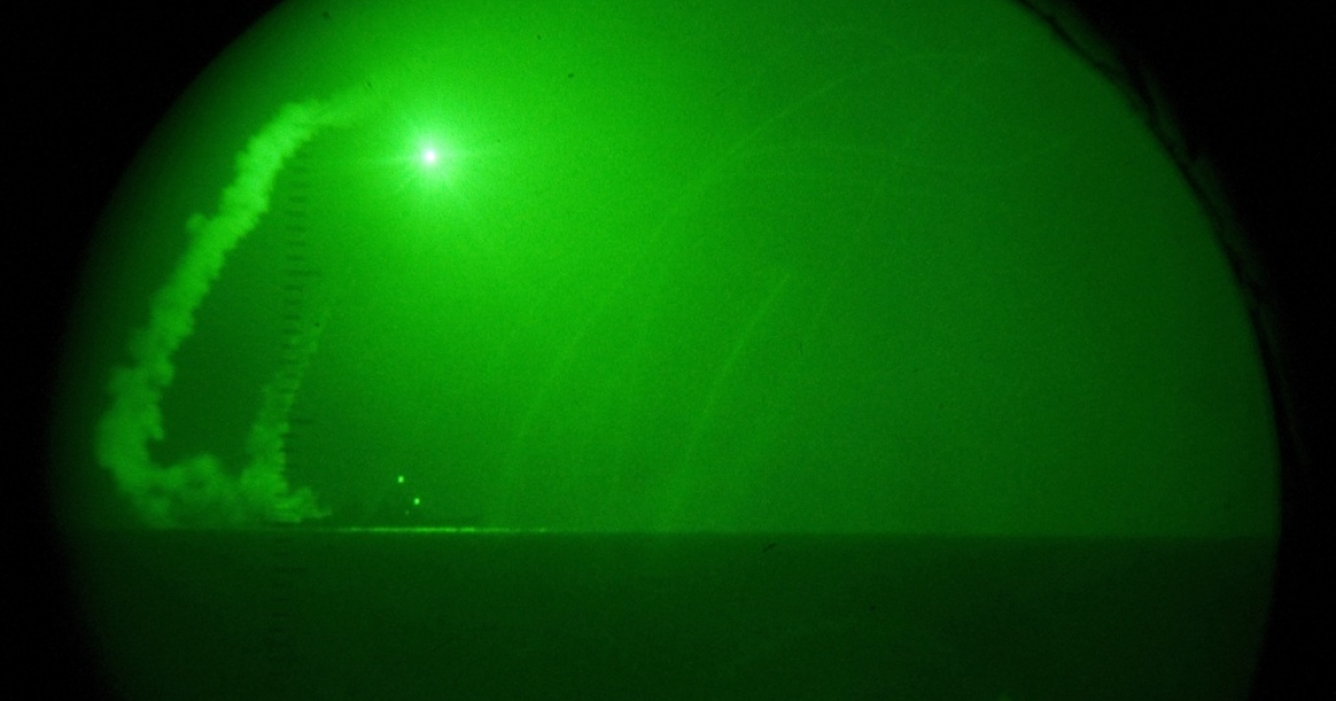 Seen through night-vision lenses aboard amphibious transport dock USS Ponce, guided missile destroyer USS Barry fires Tomahawk cruise missiles in support of Operation Odyssey Dawn off Libya's cost on Mar. 19, 2011.</p>