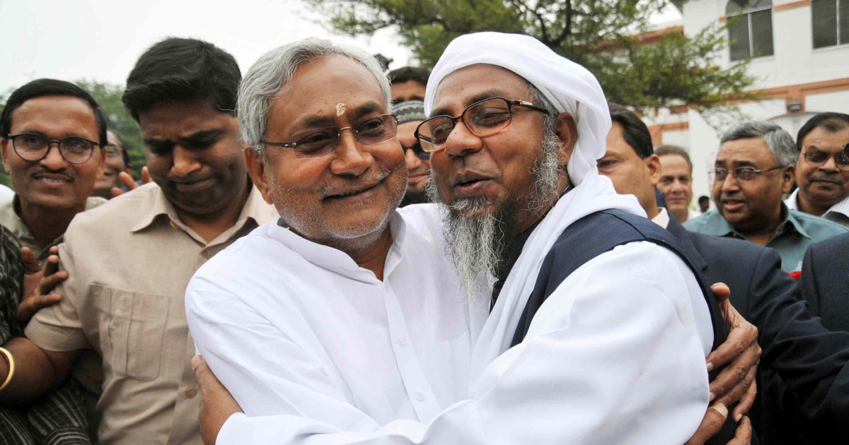 A man congratulates Bihar's Chief Minister Nitish Kumar (L) at his residence in Patna on November 25, 2010. Kumar's party is a vital partner in the Bharatiya Janata Party's (BJP) National Democratic Alliance (NDA). But in recent days he has threatened to pull out if the BJP projects Gujarat's Narendra Modi as its candidate for prime minister.</p>