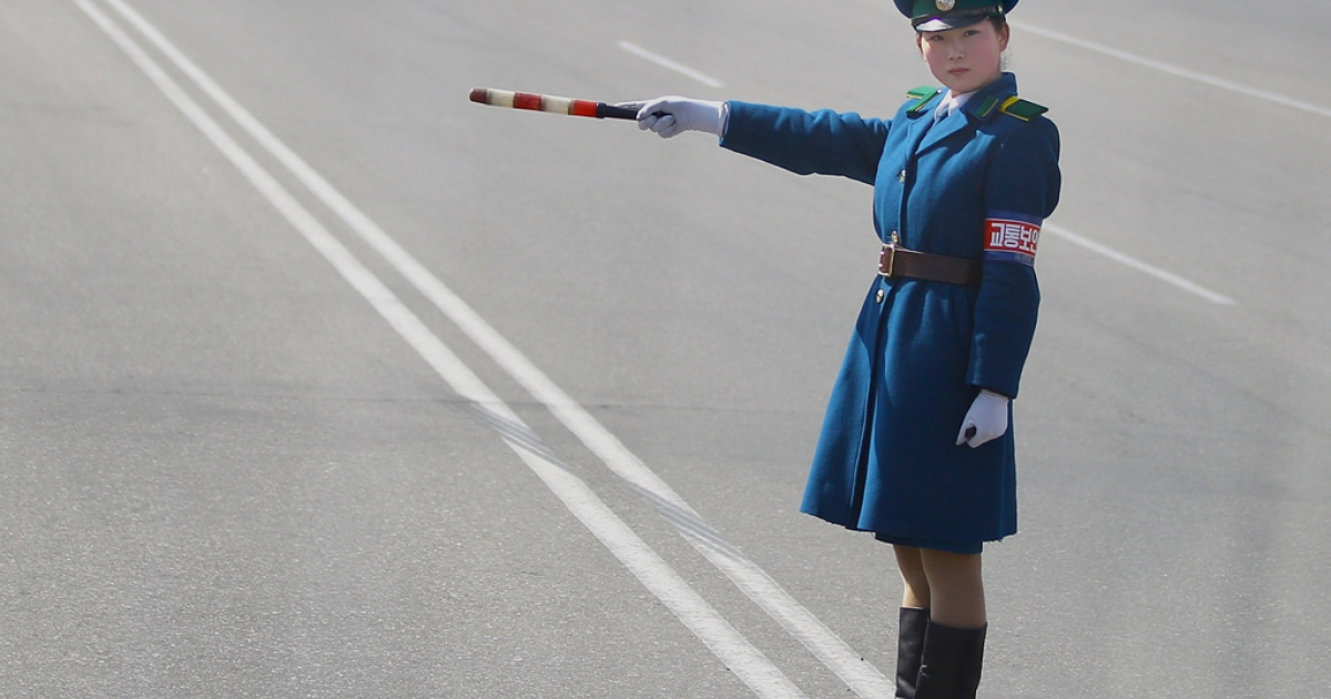 A young police woman conducts the traffic on April 3, 2011 in Pyongyang, North Korea.</p>