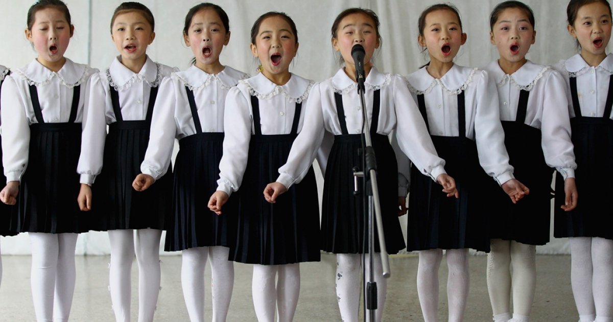North Korean children perform in a primary school on April 2, 2011 in Pyongyang, North Korea. Pyongyang is the capital city of North Korea and the population is about 2,500,000.</p>