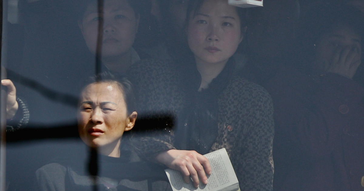 The women look out the window of a bus on April 2, 2011 in Pyongyang, North Korea.</p>