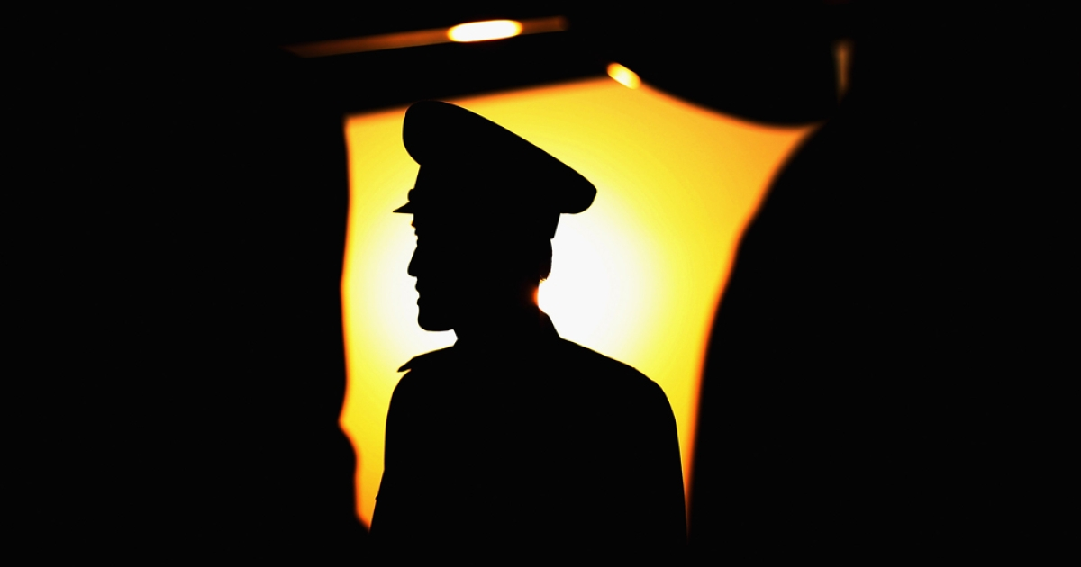 A soldier stands guard on the aircraft park of the Pyongyang Airport on April 3, 2011 in Pyongyang, North Korea.</p>