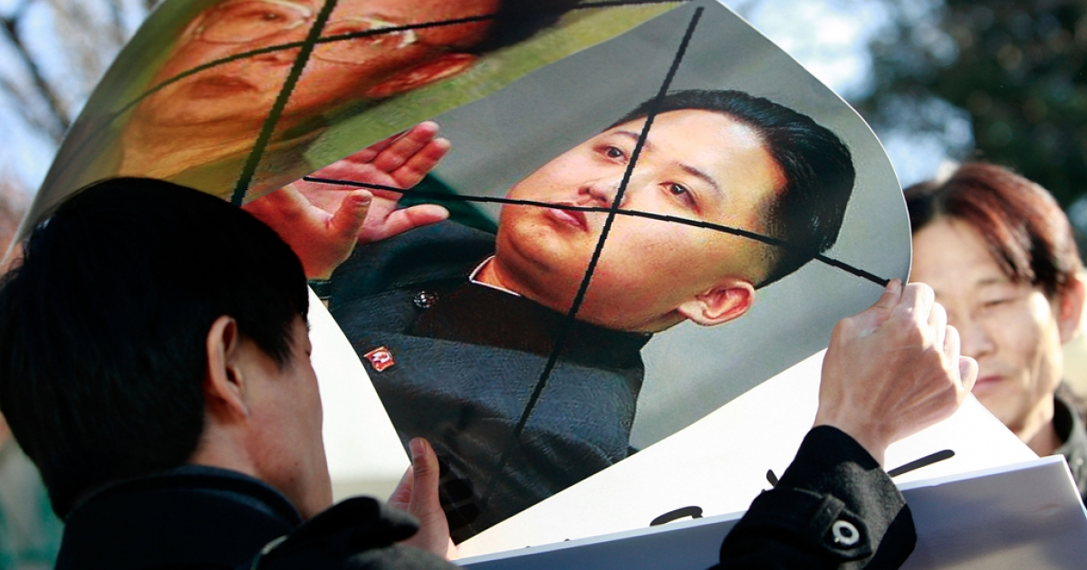 North Korean defectors hold defaced posters of North Korea leader Kim Jong Il and his son Kim Jong Un as they participate in an anti-North Korea protest in front of the South Korean Defense Ministry on Nov. 29, 2010 in Seoul.</p>