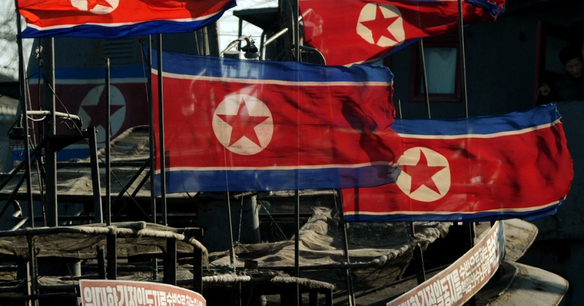 North Korean flags fly at half-mast on fishing boats after the funeral of the late leader Kim Jong Il, at the Chinese North Korean border area near Dandong on Dec. 29, 2011.</p>