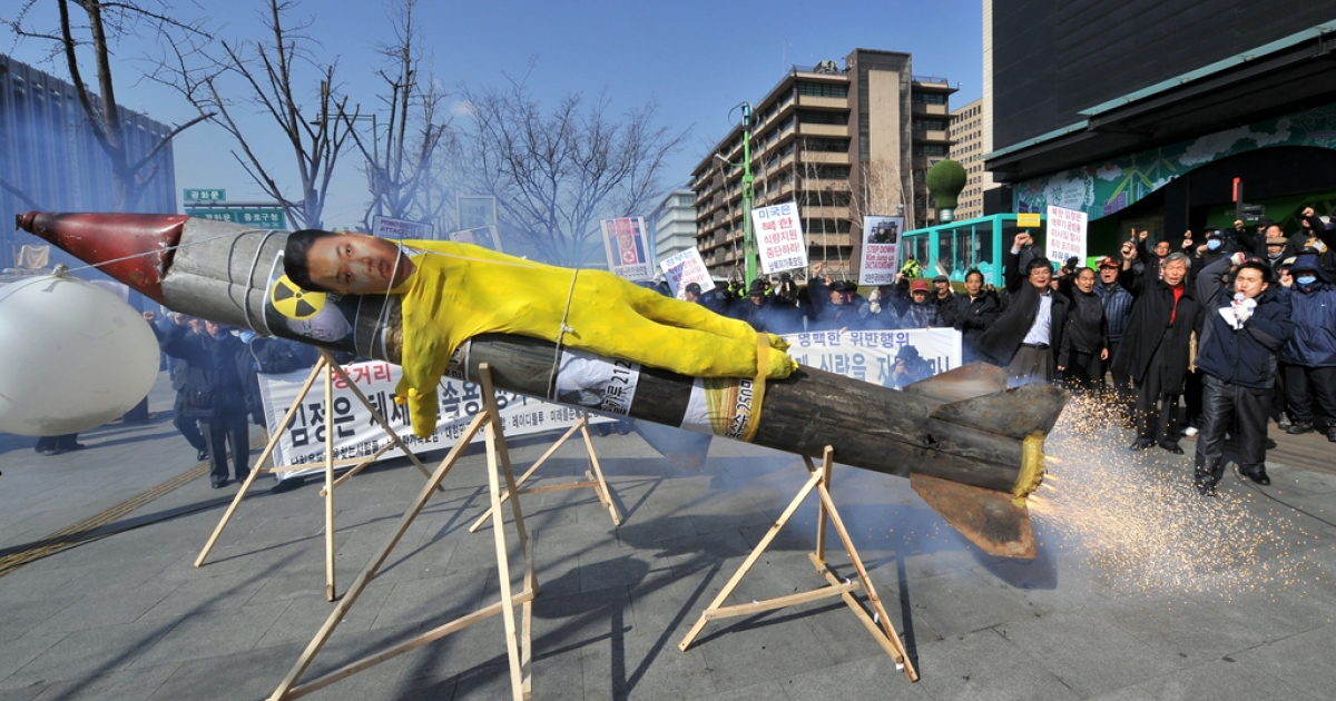 South Korean activists protest the launch of a North Korean missile with a faux missile carrying an effigy of North Korean leader Kim Jong Un, in Seoul on March 20, 2012.</p>