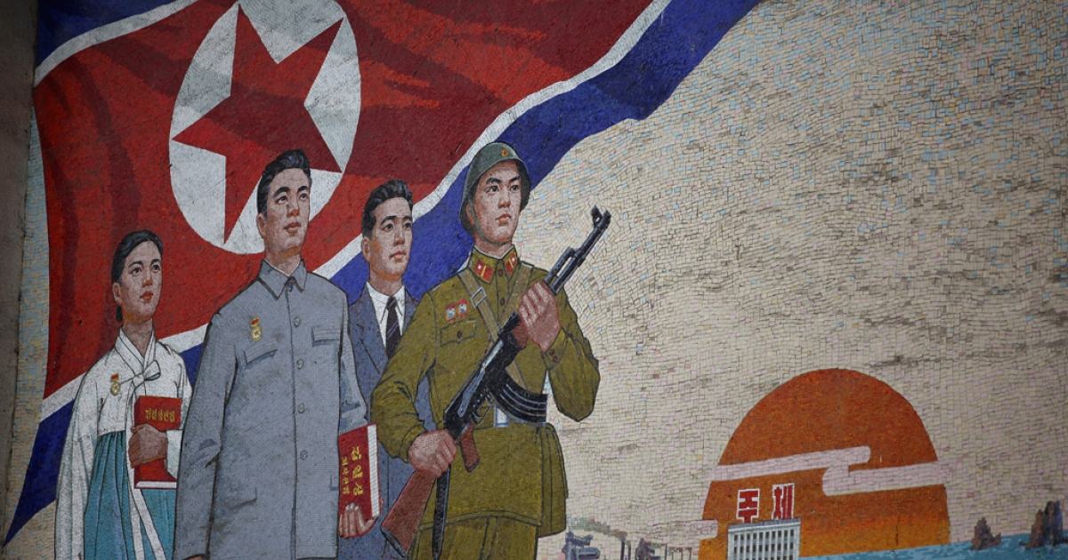 Propaganda mural painting is seen outside People's Palace of Culture on April 2, 2011 in Pyongyang.</p>