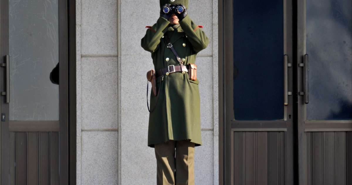 A North Korean soldier looks at the South side at the truce village of Panmunjom in the Demilitarized Zone separating the two Koreas on January 19, 2011.</p>