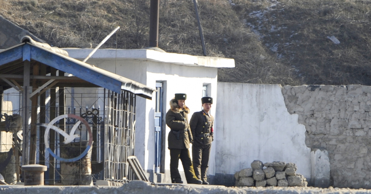 North Korean soldiers stand guard along the bank of the Yalu River in the North Korean town of Sinuiji, on Dec. 22, 2011.</p>