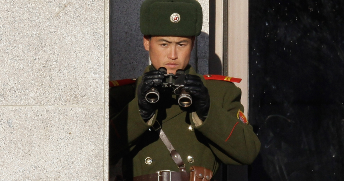 A North Korean soldier looks at South Korea across the Korean Demilitarized Zone (DMZ), on Dec. 22, 2011 in Panmunjom, South Korea.</p>