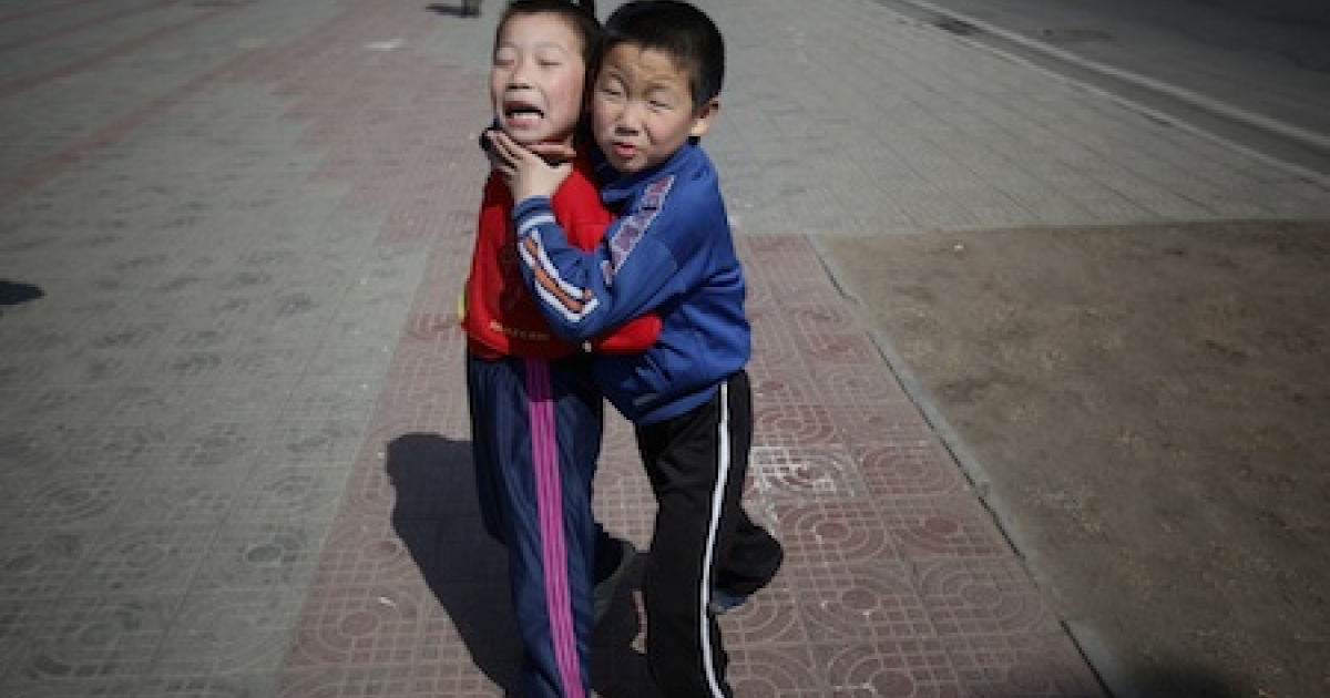 Two North Korean boys playing in the street on April 2, 2011 in Pyongyang, North Korea.</p>
