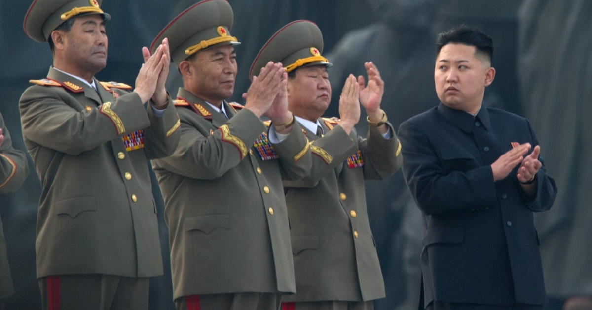 North Korean leader Kim Jong-Un (R) claps as he attends the unveiling ceremony of two statues of former leaders Kim Il-Sung and Kim Jong-Il in Pyongyang on April 13, 2012. North Korea's new leader Kim Jong-Un on April 13 led a mass rally for his late father and grandfather following the country's failed rocket launch.</p>