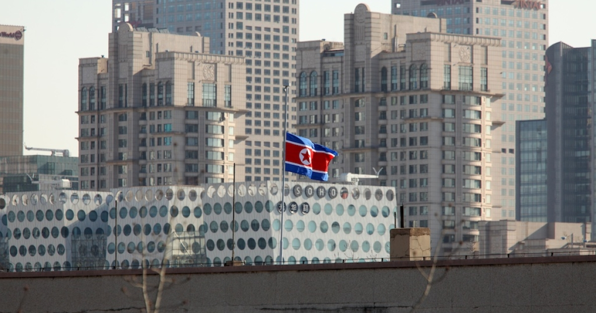 A North Korean national flag flies at half-mast above the North Korean embassy in Beijing on December 22, 2011 following the sudden death of former leader Kim Jong-il.</p>