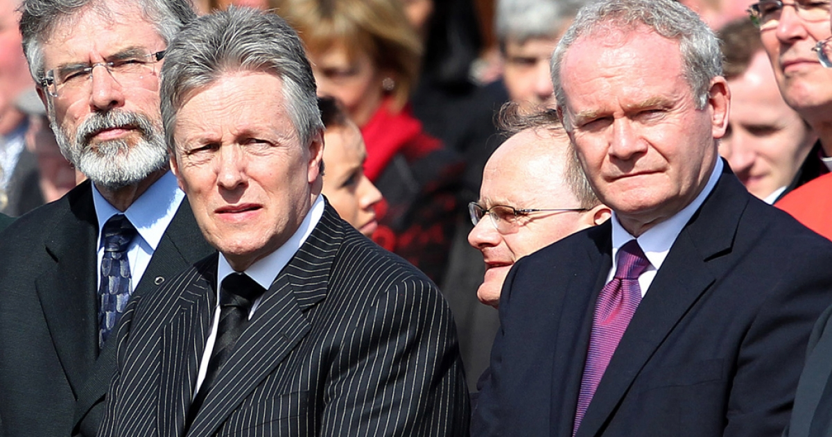 Sinn Fein President Gerry Adams (left), Northern Ireland First Minister Peter Robinson (middle) and Deputy First Minister Martin McGuiness stand together as the coffin containing the remains of Police Constable Ronan Kerr is carried from the church of the Immaculate Conception in Beragh, Northern Ireland, on April 6, 2011.</p>