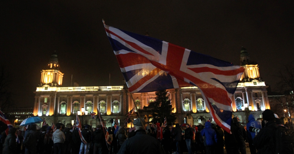 Loyalist protesters gather at Belfast City Hall during a city council meeting in Belfast, Northern Ireland on January 7, 2013.</p>