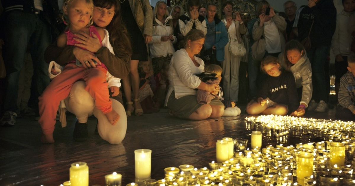 OSLO, Norway — JULY 24:  Friends and loved ones gather at the Oslo cathedral saying prayers and lighting candles on July 24 ,2011 to mourn victims killed in twin terror attacks from a bombing in downtown Oslo and a mass shooting on Utoya island.</p>