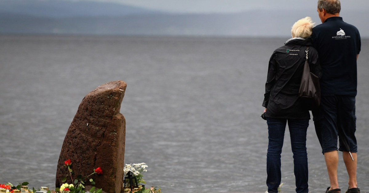 A man and woman look out across Tyrifjorden Lake towards Utoya Island on July 24, 2011, in Norway. Anders Behring Breivik, 32, killed 77 people in attacks in Oslo and on the island.</p>
