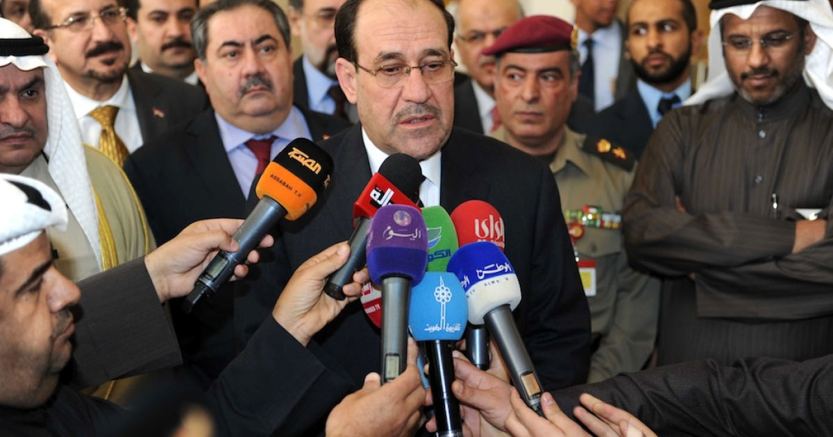 Iraqi Prime Minister Nouri al-Maliki (C) speaking to reporters during his visit to Kuwait's National Assemly in Kuwait City on March 14, 2012.</p>