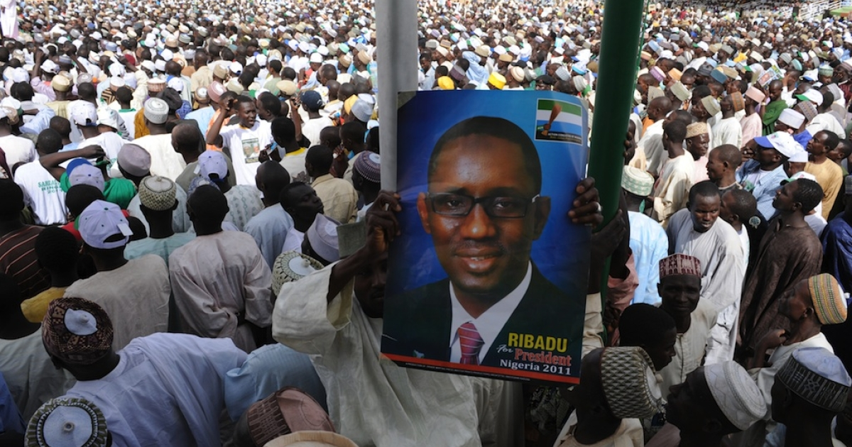 At a rally in Dutse, Jigawa a party supporter holds a poster of then presidential candidate Nuhu Ribadu on Feb. 28, 2011.</p>