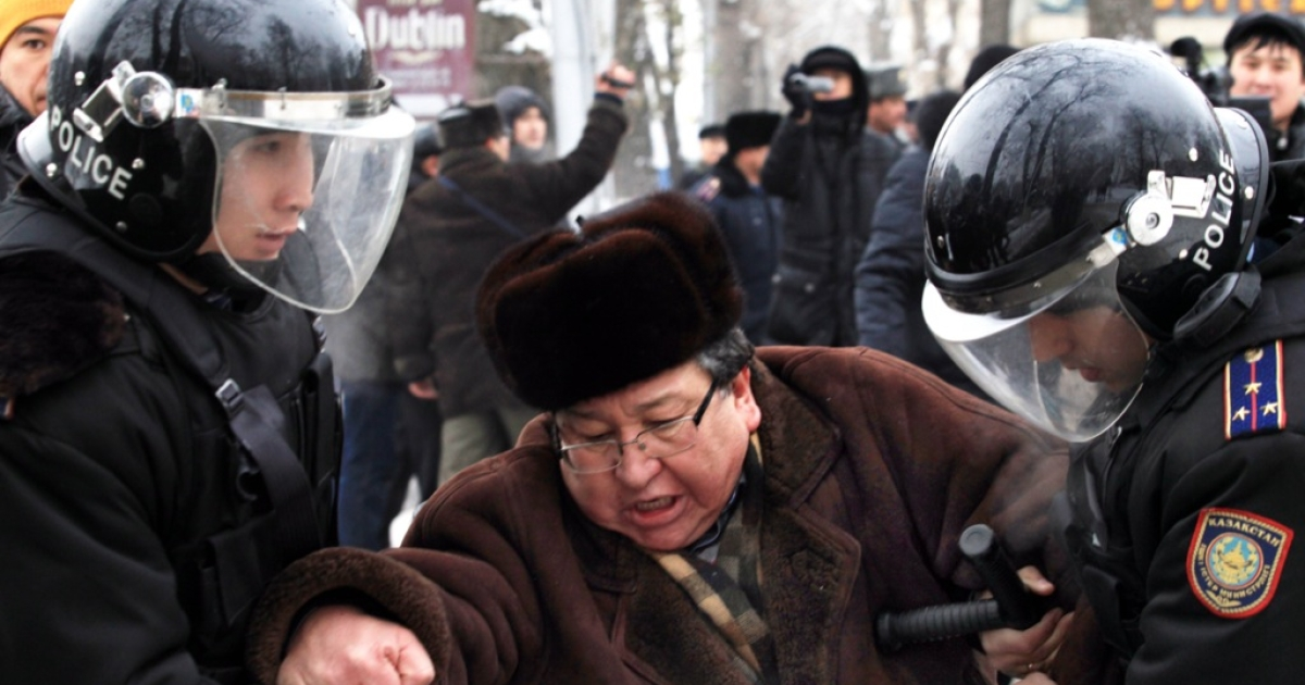 Kazakh riot policemen detain an opposition supporter during a rally in Almaty on December 17, 2011. Authorities in Kazakhstan declared Saturday that clashes between police and striking oil workers in Zhanaozen were under control as information from the region slowed to a trickle due to an apparent blockade.</p>