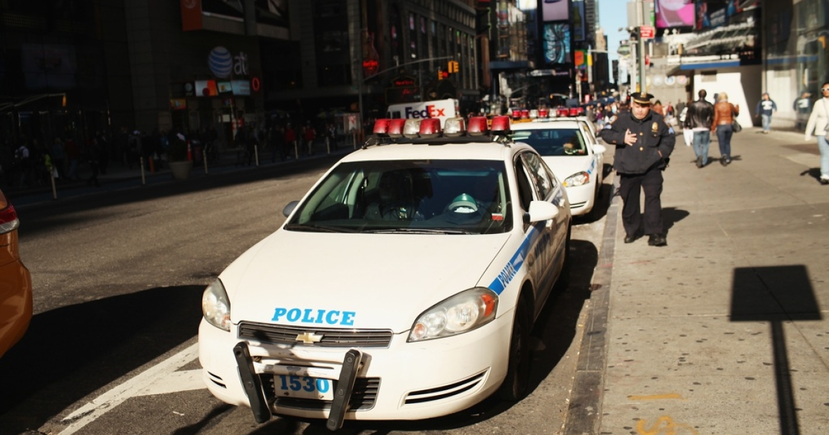 New York City Police cars are parked on the street in Times Square on October 25, 2011 in New York City.</p>