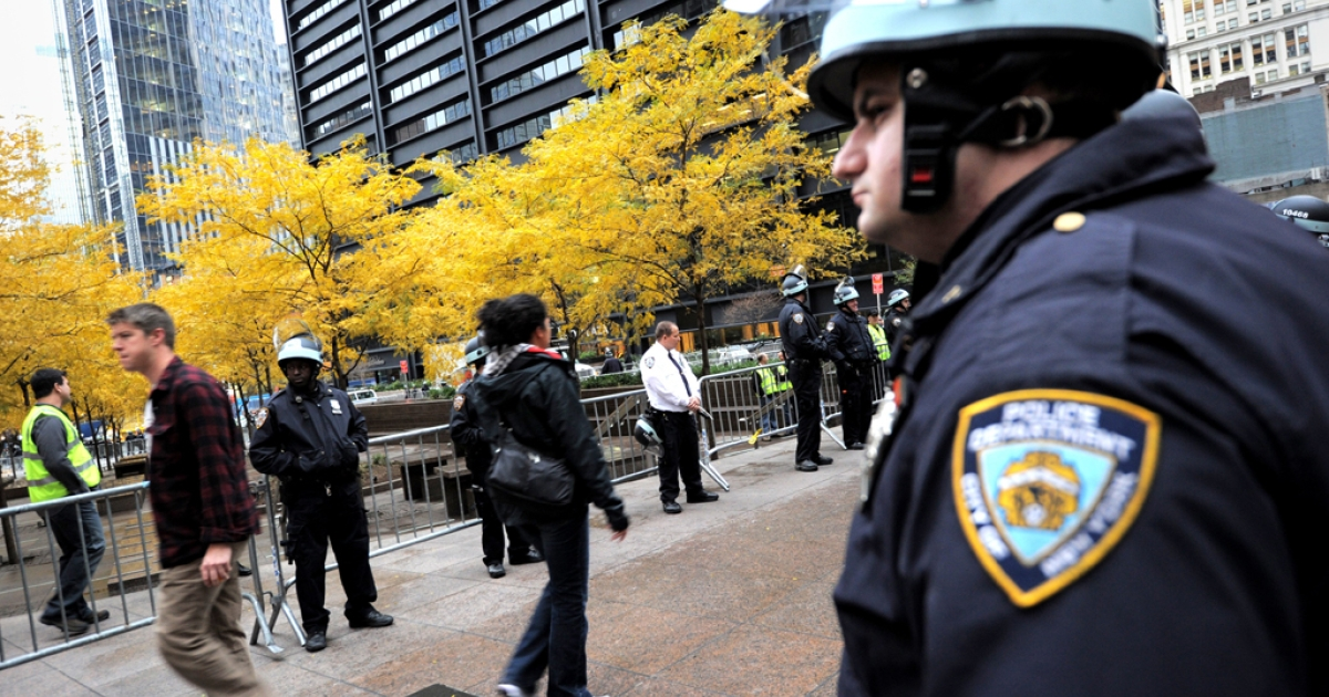 An NYPD officer stands near Zuccotti Park in New York. Recently, the department has come under fire after a Facebook group containing racist comments is linked with several of its officers.</p>