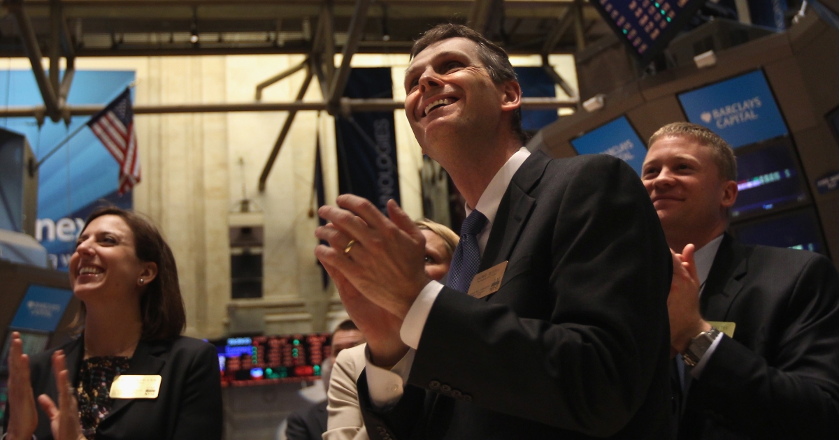 Applause breaks out at the New York Stock Exchange at the closing bell on Feb. 21, 2012, when the Dow Jones industrial average broke through the 13,000 barrier for the first time since May 2008.</p>