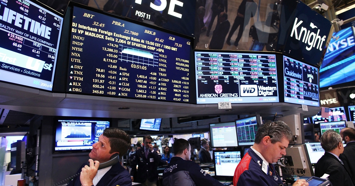 Traders work on the floor of the New York Stock Exchange in New York City on May 1, 2012.</p>