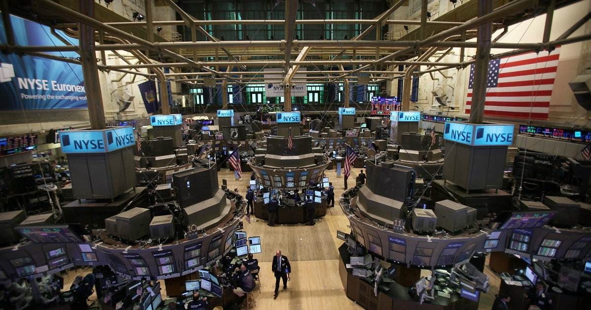 Traders work on the floor of the New York Stock Exchange (NYSE) in New York City. Stocks surged higher, the fourth straight week of gains for Wall Street.</p>