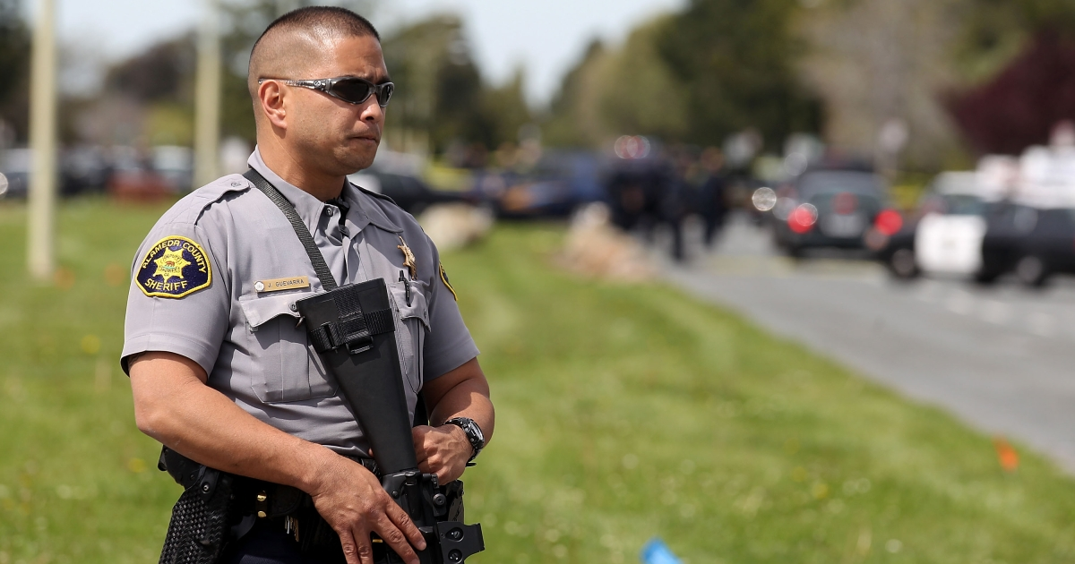 Police secure the scene at Oikos University after a shooting that killed multiple people on Monday in Oakland, California.</p>
