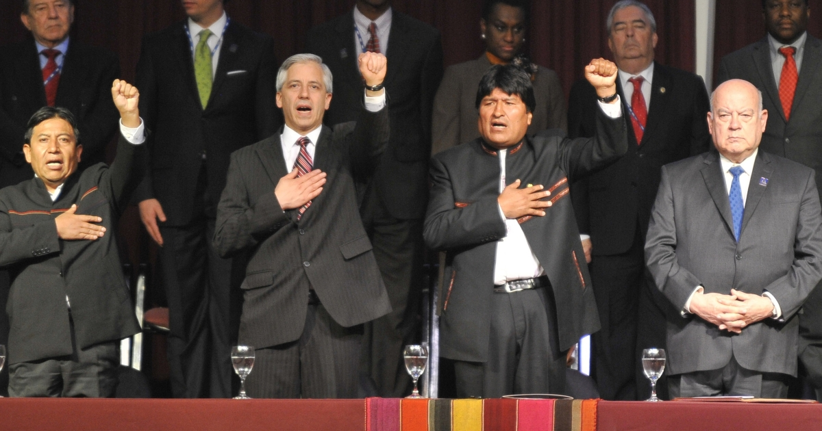 Bolivian President Evo Morales, second from right, sings his national anthem next to OAS Secretary General Jose Miguel Insulza, right.</p>