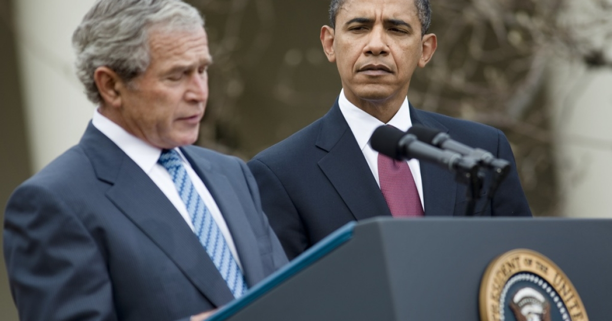 President Barack Obama listens as President George W. Bush speaks about American aid to Haiti during a press conference at the White House on January 16, 2010.</p>