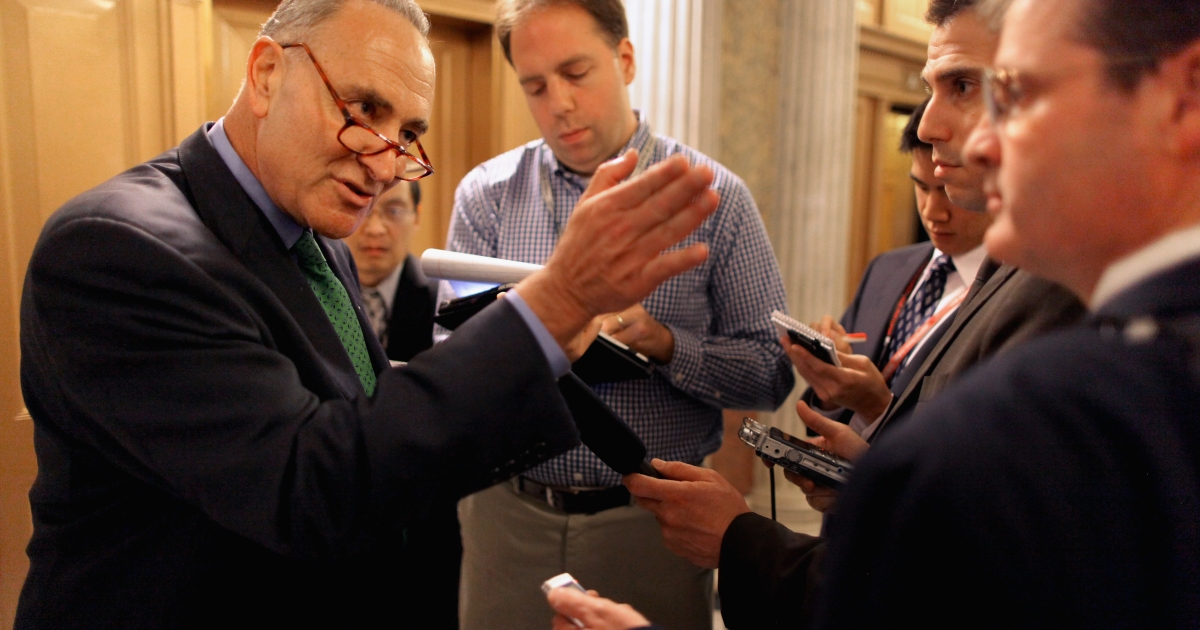 Sen. Charles Schumer (D-N.Y.) talks with reporters after voting for President Barack Obama's America Jobs Act on October 11, 2011 in Washington, D.C.</p>