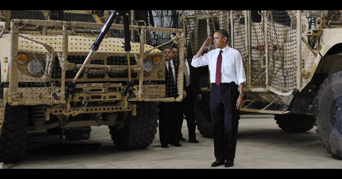 US President Barack Obama salutes as he arrives to address troops during a visit to Bagram Air Field on May 1, 2012 in Afghanistan.</p>