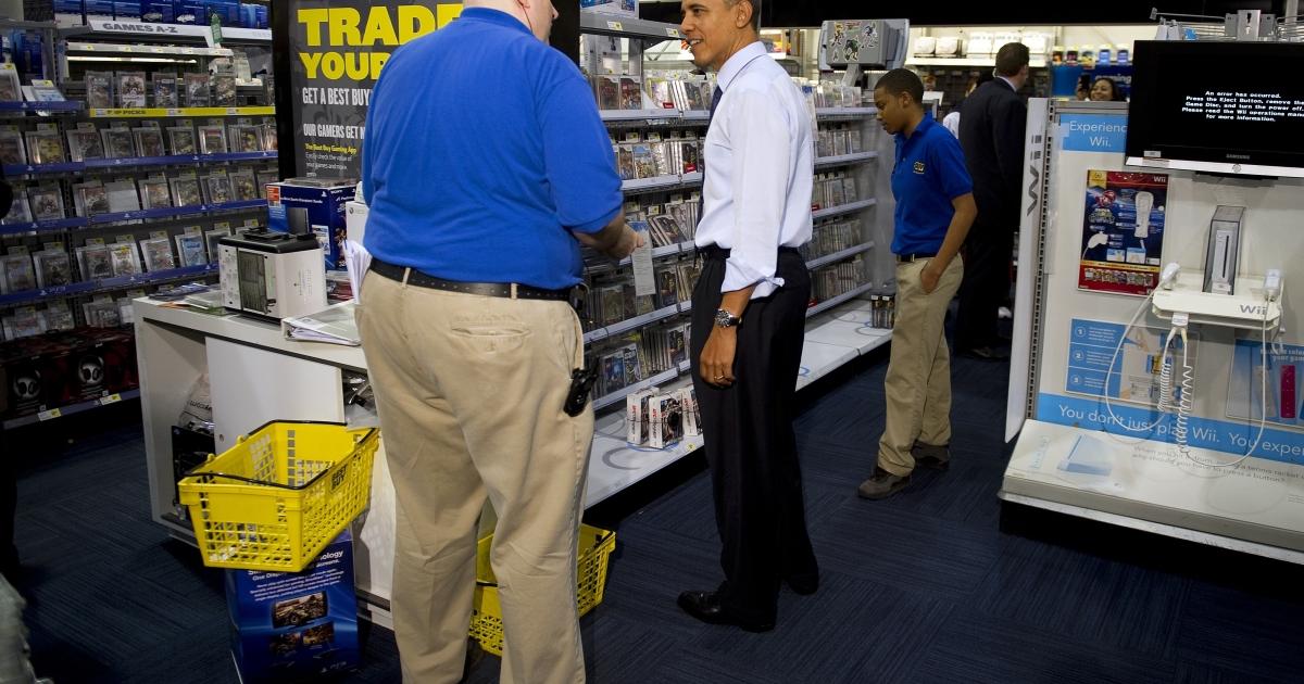 President Barack Obama speaks with clerks as he shops at Best Buy in Alexandria, Va., on Dec. 21, 2011.</p>