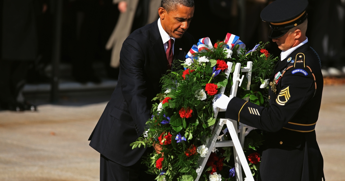 President Barack Obama (L) is assisted by Sgt.1st Class Chad Eric Wayne Stackpole, 3rd U.S. Infantry Regiment Sergeant of the Guard, in placing a wreath at the Tomb of the Unknowns during a Veterans Day full honor ceremony at Arlington National Cemetery in Arlington, Va., on Nov. 11, 2011.</p>