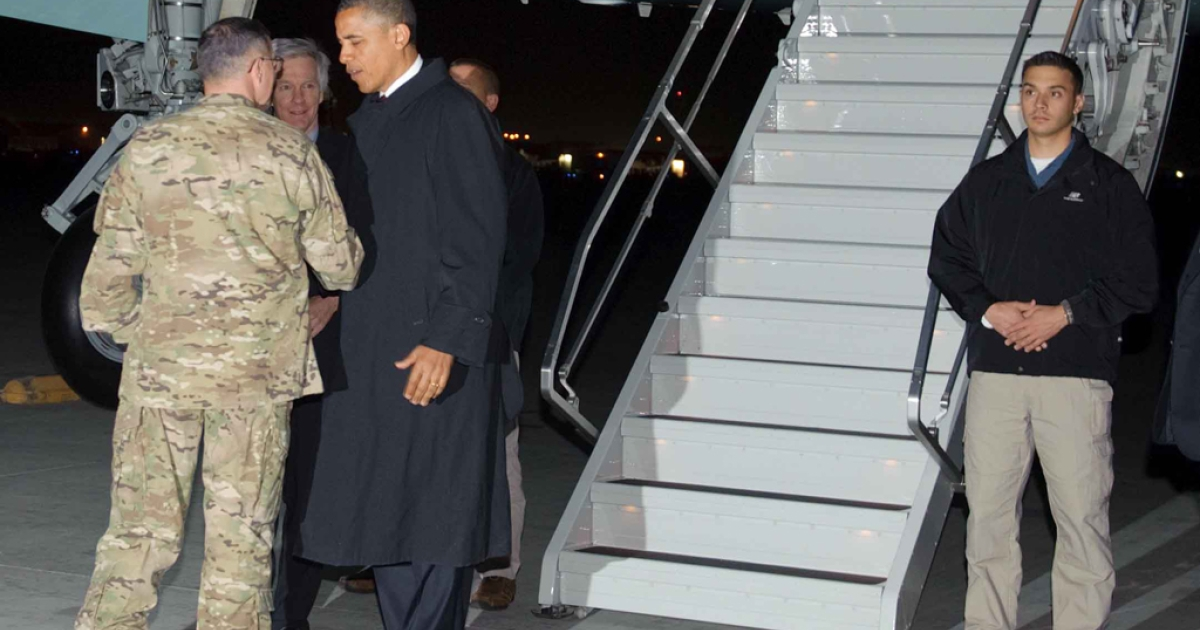 US President Barack Obama is greeted by Lieutenant General Curtis Scaparrotti and US Ambassador to Afghanistan Ryan Crocker on May 1, 2012 upon arrival at Bagram Air Field, some 50km north of Kabul. Obama arrived in Afghanistan for a previously unannounced visit.</p>