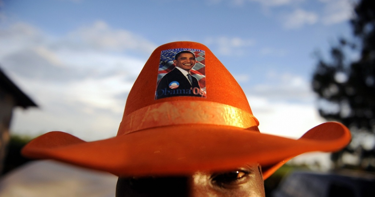 A supporter of US Democratic presidential hopeful Barak Obama sports a hat bearing a sticker of Obama in the village of Kogello on November 4, 2008.</p>