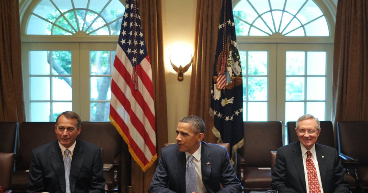 President Obama, House Speaker Boeher (left), and Senate Majority Leader Harry Reid at a debt meeting with congressional leaders in the Cabinet Room at the White House on July 13, 2011.</p>