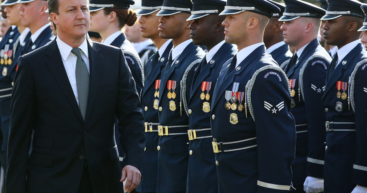 British Prime Minister David Cameron inspects the troops during an official arrival ceremony at the South Lawn of the White House March 14, 2012 in Washington, DC. Cameron's position on Iran closely mirrors that of US President Barack Obama.</p>