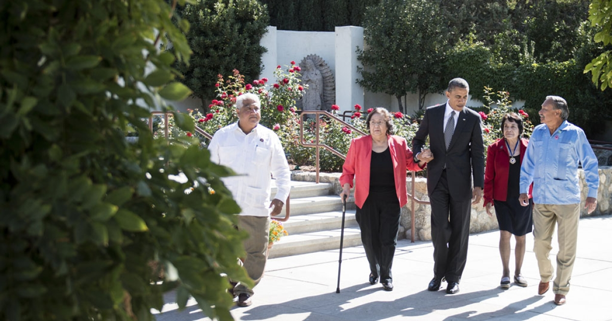(L-R) Paul F. Chavez, son of Cesar Chavez; Helen F. Chavez, widow of Cesar Chavez; President Barack Obama; Dolores Huerta, co-founder of the United Farm Workers; and Arturo S. Rodriguez, president of the United Farm Workers, walk to visit the grave of Cesar Chavez during a tour of a memorial garden at the Chavez National Monument Oct. 8, 2012 in Keene, California.</p>