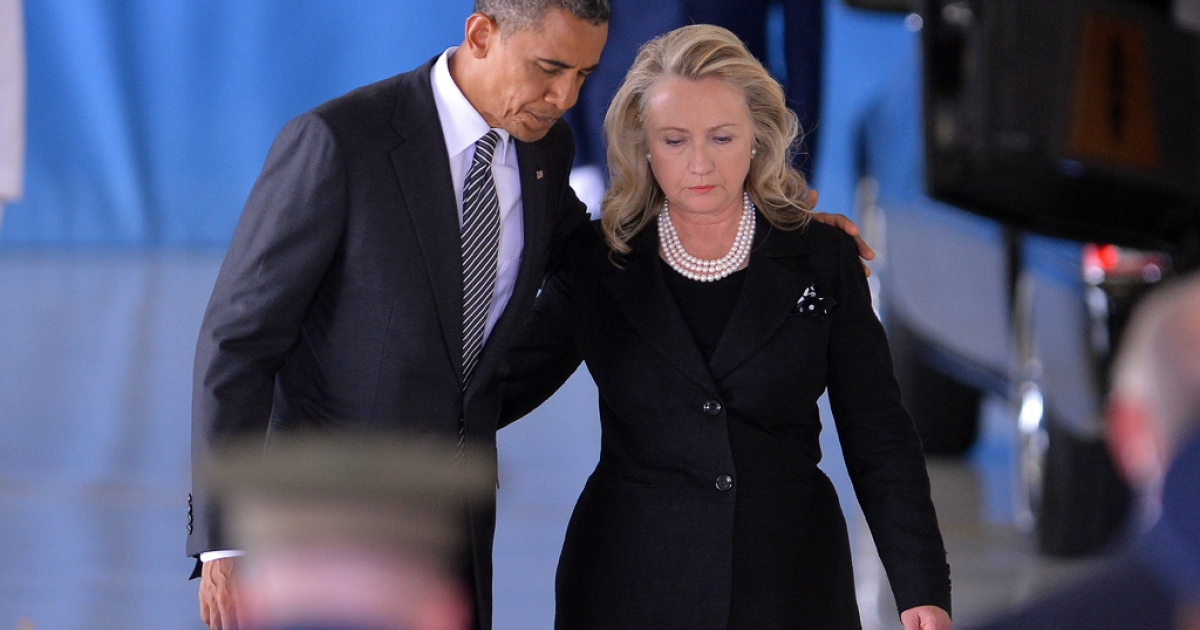 US President Barack Obama and State Secretary Hillary Clinton return to their seats after speaking during the transfer of remains ceremony marking the return to the US of the remains of the four Americans killed in an attack this week in Benghazi, Libya, at the Andrews Air Force Base in Maryland on September 14, 2012.</p>
