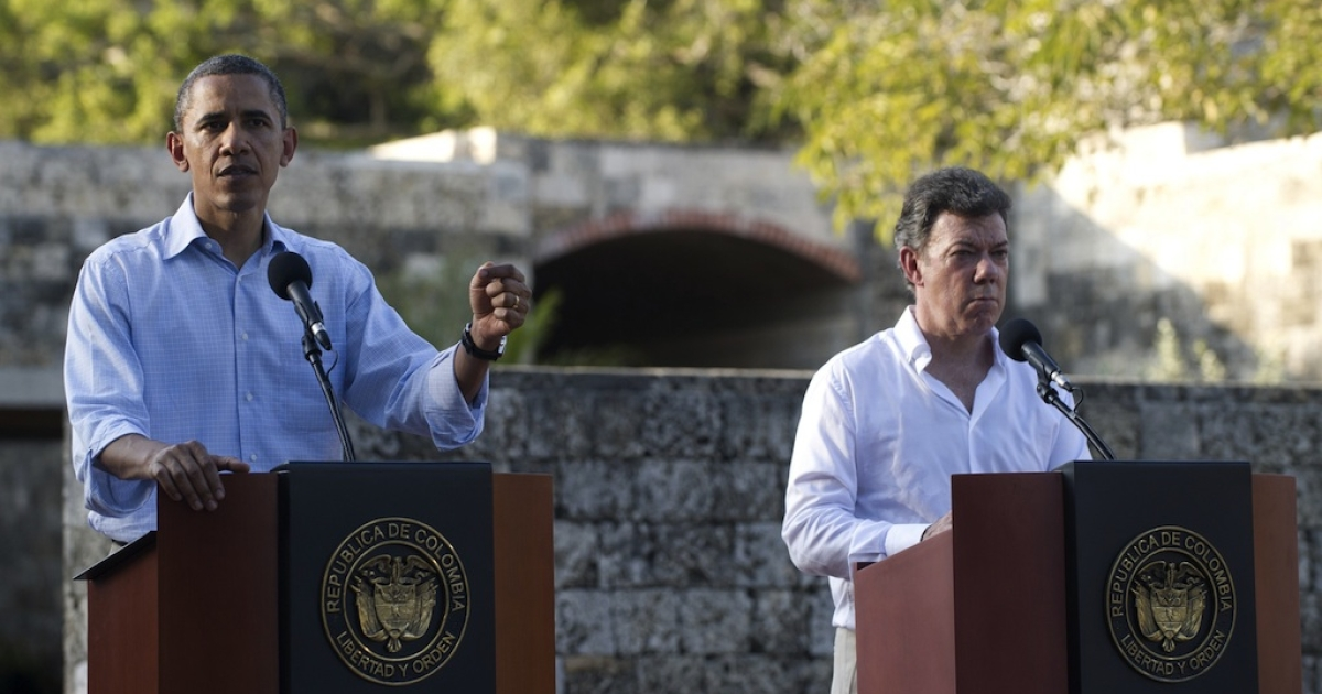 US President Barack Obama (L) and Colombian President Juan Manuel Santos deliver a joint press conference in the framework of the VI Summit of the Americas at Casa de Huespedes in Cartagena, Colombia, on April 15, 2012.</p>
